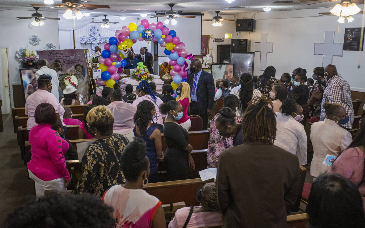 Family and friends gather inside the chapel for the funeral service for Sayah Deal at the Tried ...