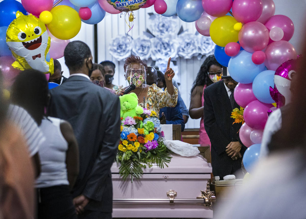 Diana Daniels gives a prayer as all stand during the funeral service for Sayah Deal at the Trie ...
