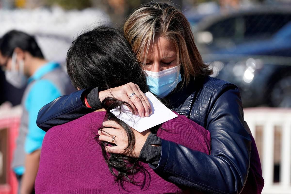 Jill McCluskey, right, the mother of slain University of Utah student-athlete Lauren McCluskey, ...