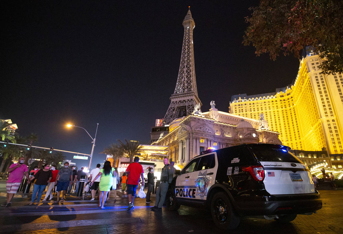 Metropolitan police are present outside Paris Las Vegas following a major power outage in the h ...