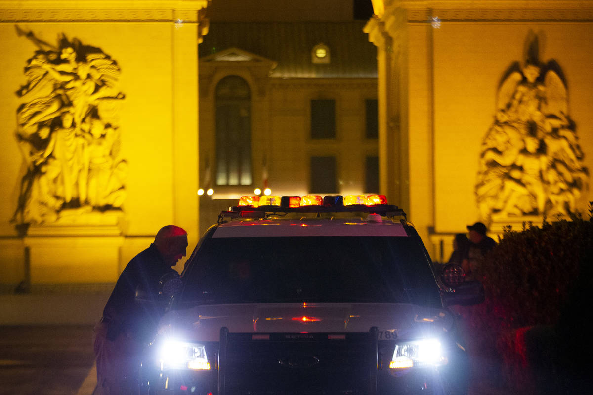 Metropolitan police are present outside Paris Las Vegas following a power outage, which resulte ...