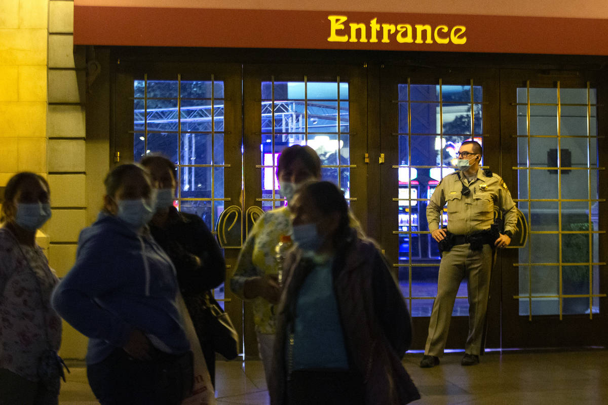 Metropolitan police guard the doors outside Paris Las Vegas following a power outage as evacuat ...