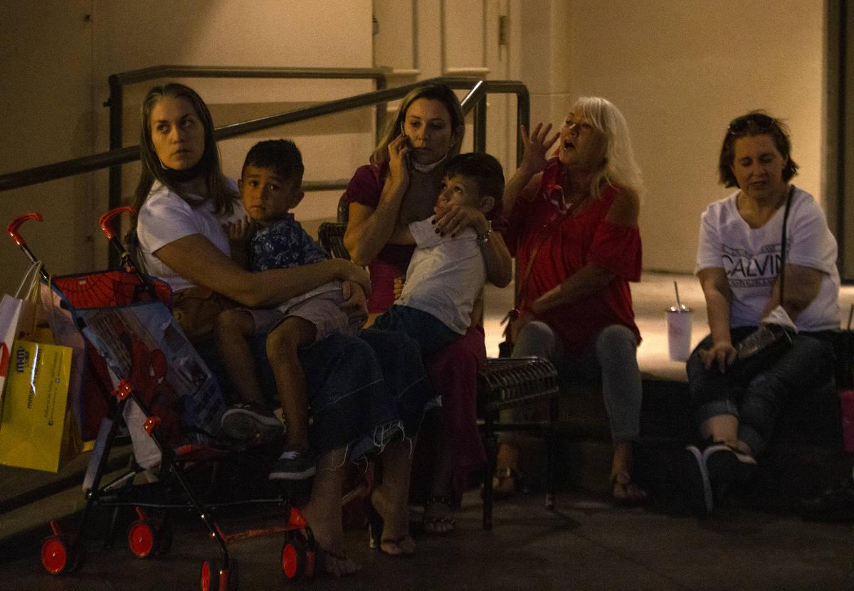 Damaris Luquez and her 5-year-old son Rabhael Lima, left, wait outside Paris Las Vegas after a ...