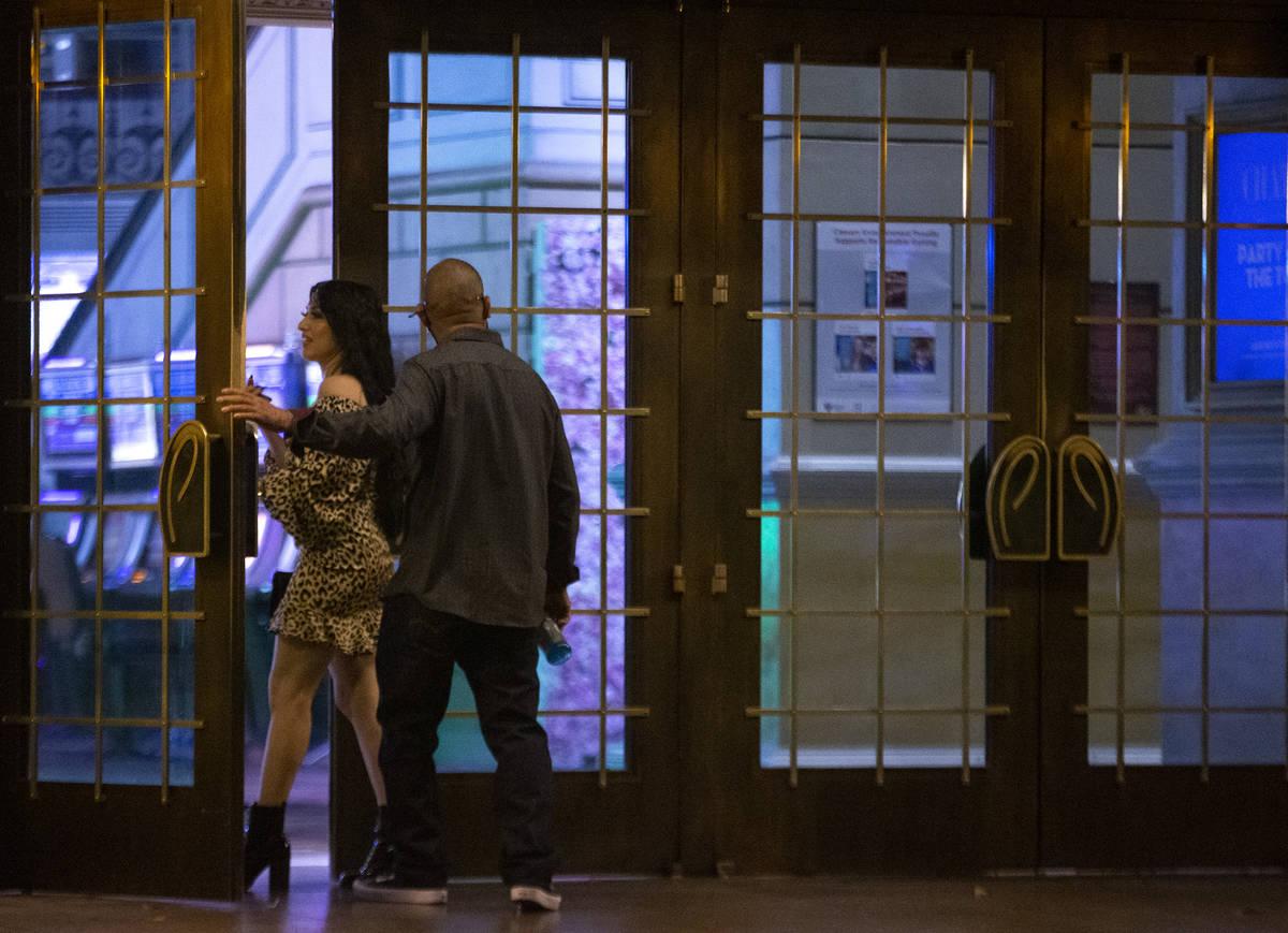 People enter Paris Las Vegas following a building evacuation due to a power outage on Thursday, ...