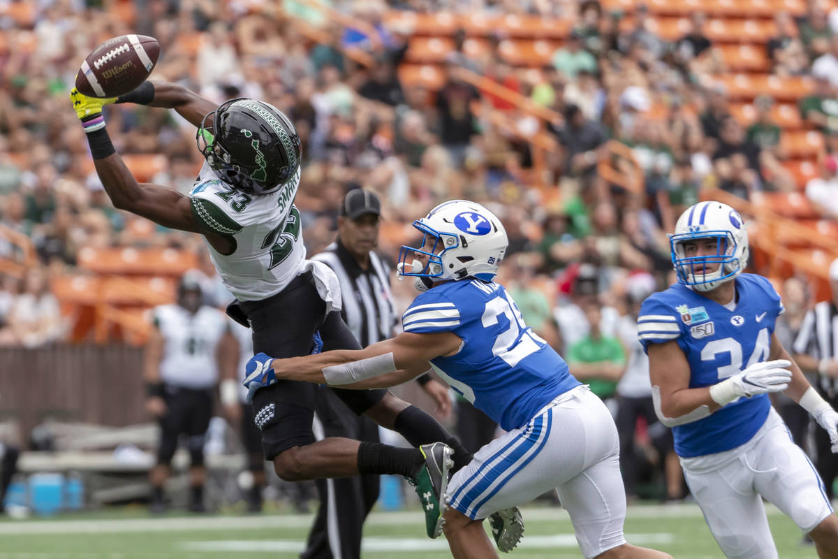 The football is just out of reach of Hawaii wide receiver Jared Smart (23) as BYU defensive bac ...