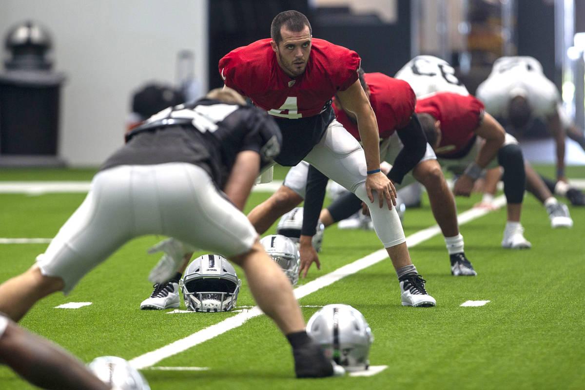 Las Vegas Raiders quarterback Derek Carr (4) stretches during a practice session at the team's ...