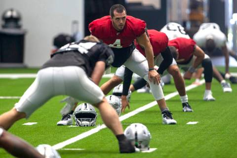 Las Vegas Raiders quarterback Derek Carr (4) stretches during a practice session at the team's ...