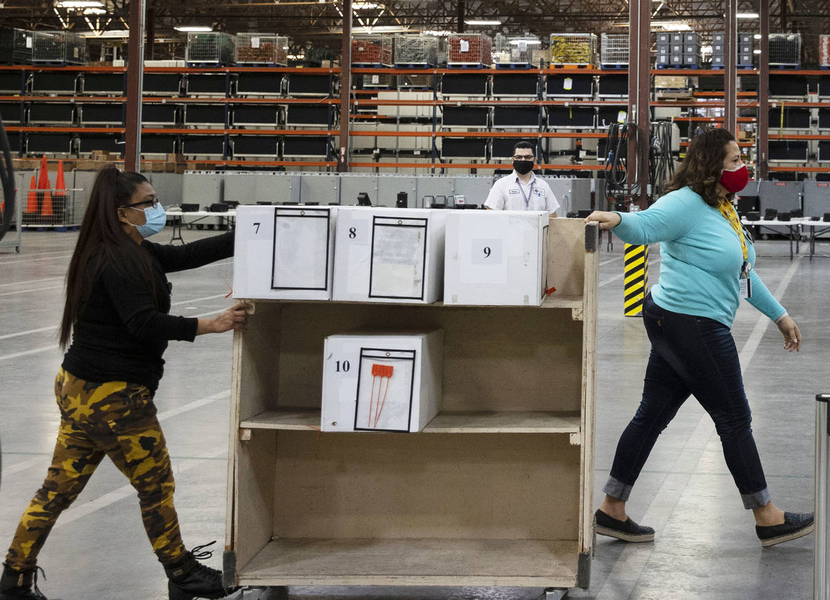 Clark County election workers deliver ballots to be counted at the Election Department warehous ...