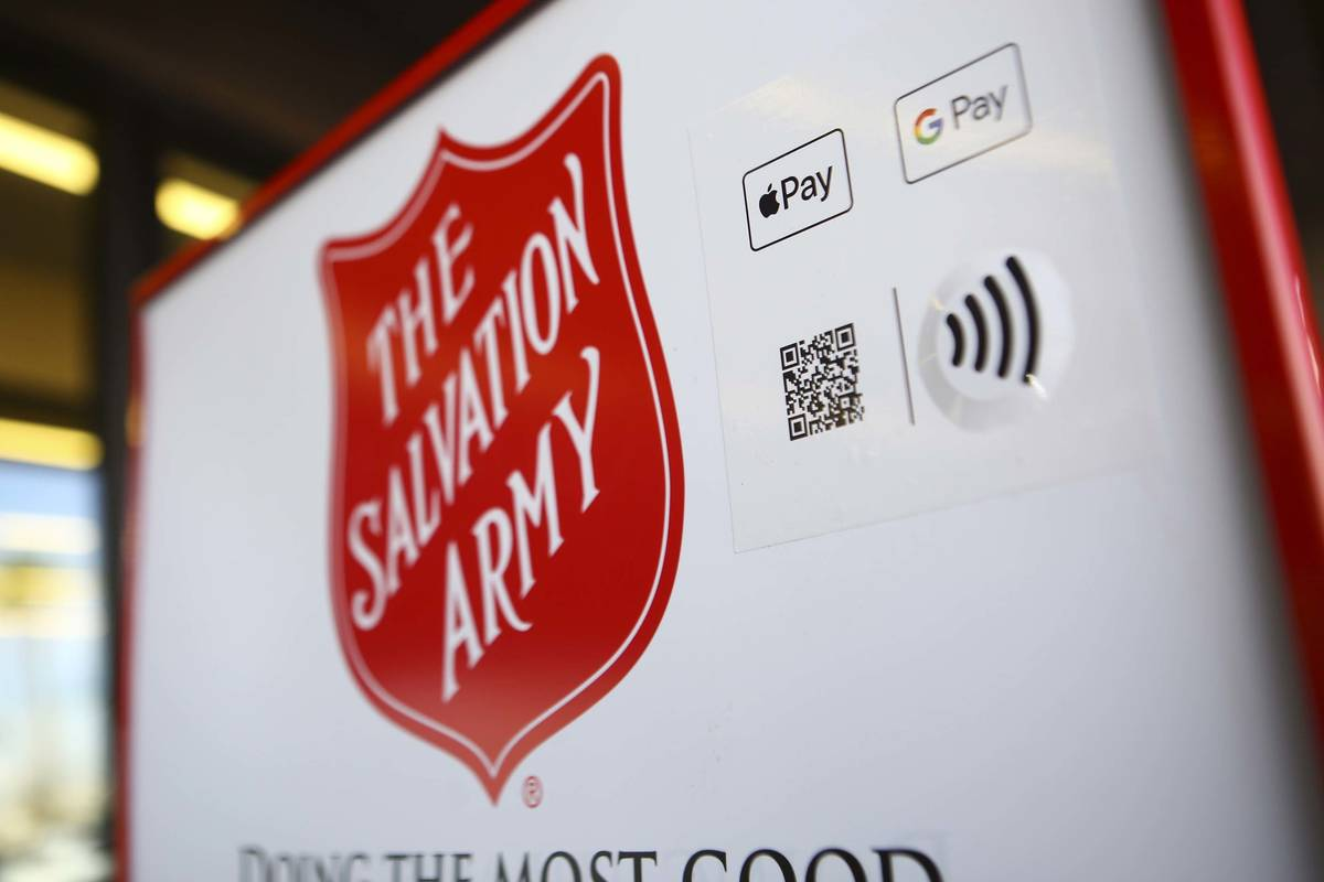 Signage for The Salvation Army featuring a QR code that allows users to donate with their mobil ...
