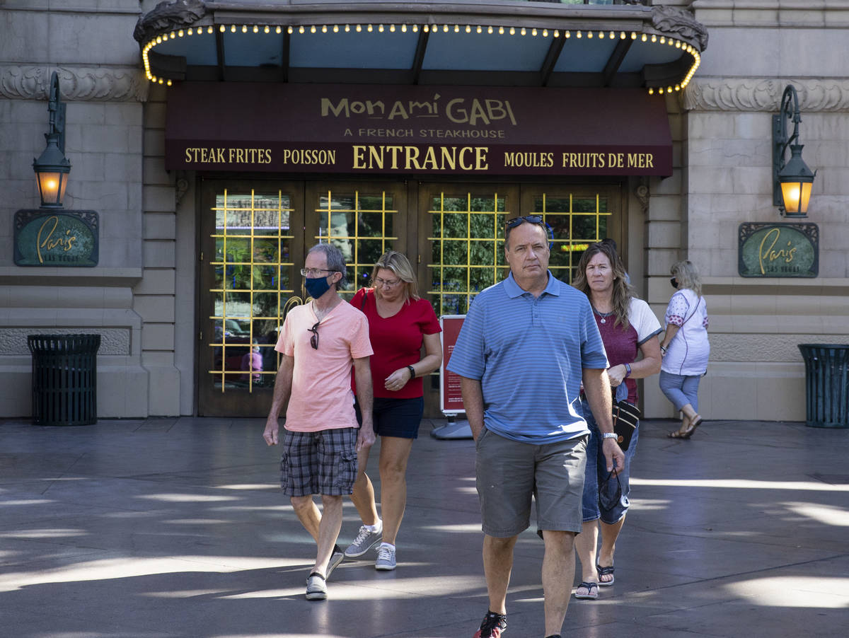 Tourist exit Paris Las Vegas on Friday, Oct. 23, 2020, in Las Vegas. Hundreds of guests at the ...