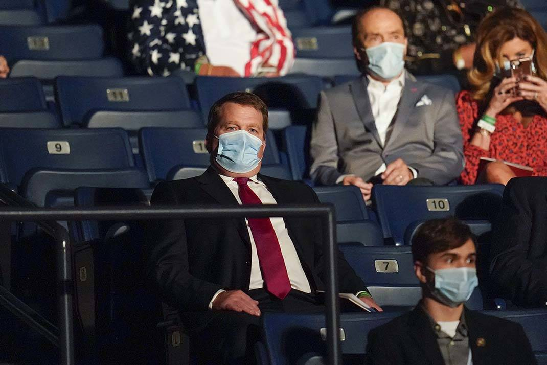 Tony Bobulinski, center seated, who says he is a former associate of Hunter Biden, waits for th ...