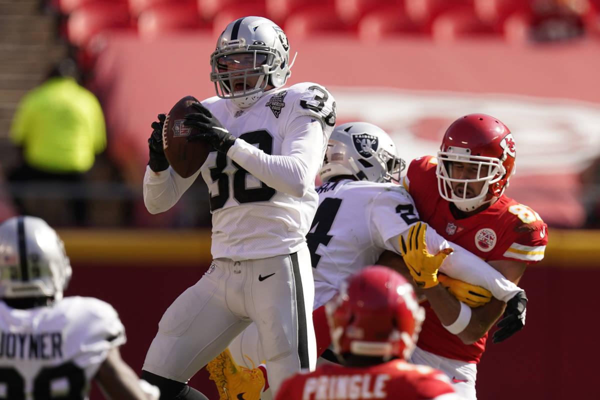 Las Vegas Raiders strong safety Jeff Heath (38) intercepts a Kansas City Chiefs quarterback Pat ...
