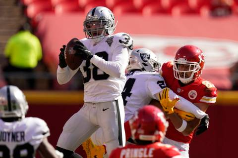 Las Vegas Raiders strong safety Jeff Heath (38) intercepts a Kansas City Chiefs quarterback Pat ...