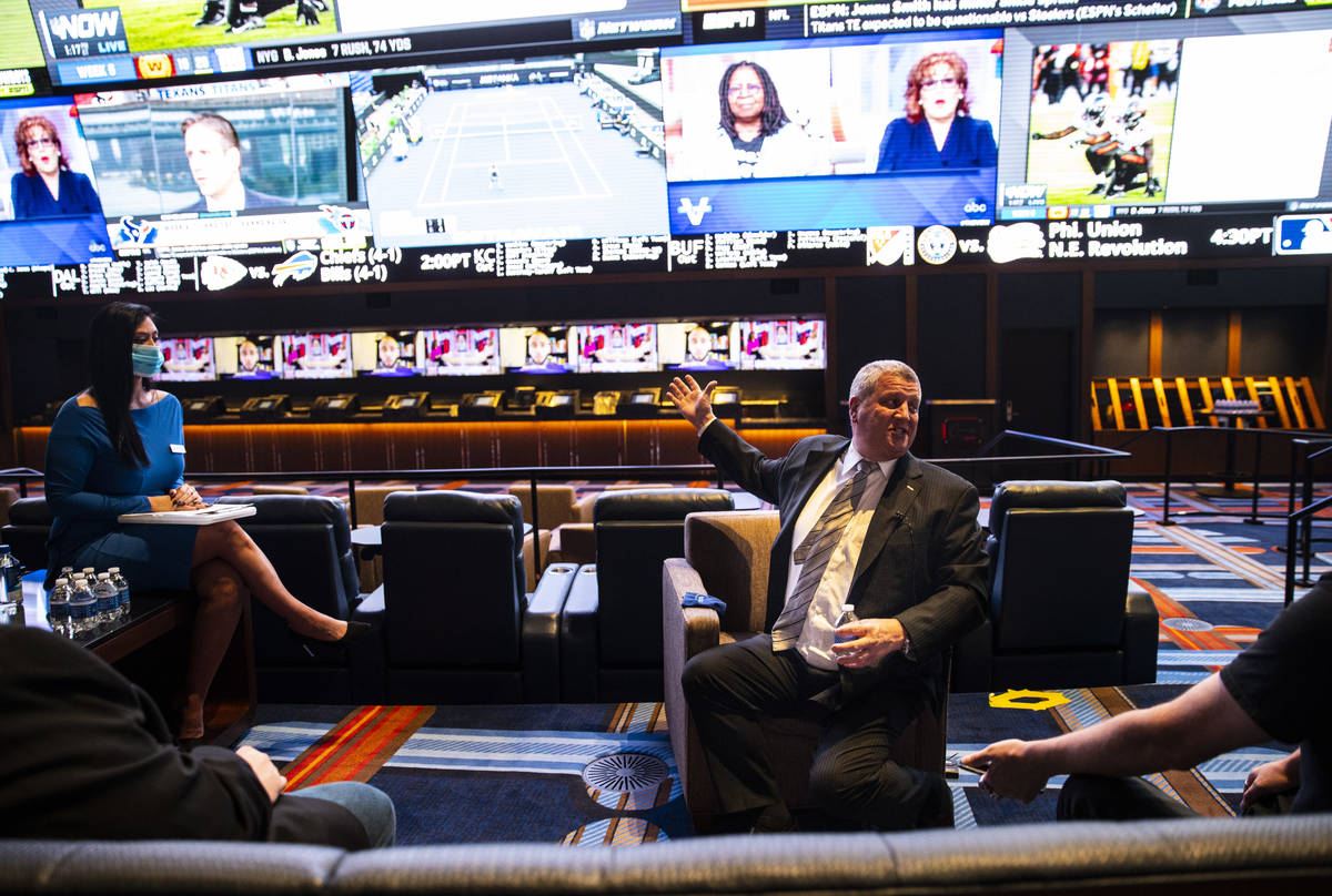 Casino owner Derek Stevens points to the display at the Circa Sportsbook on Monday, Oct. 19, 20 ...