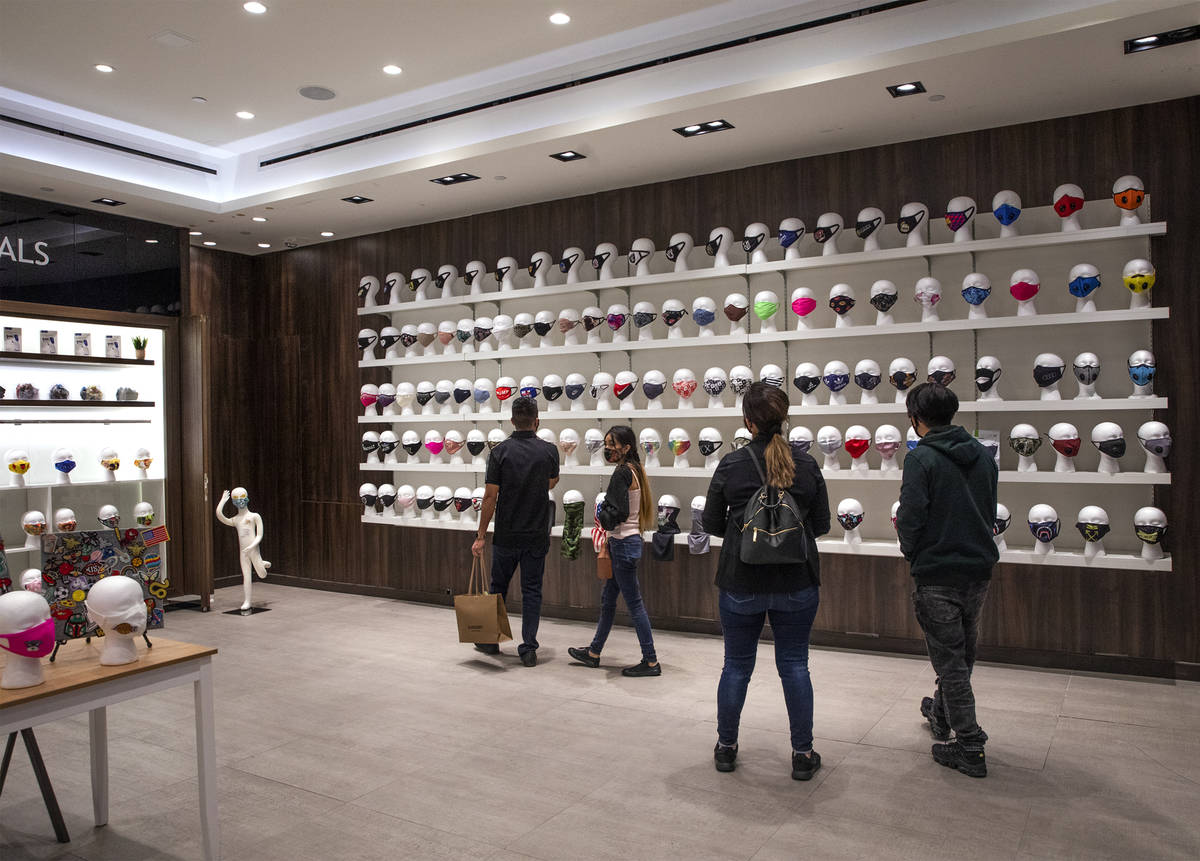 Customers shop at the COVID-19 Essentials store in the Forum Shops at Caesars Palace in Las Veg ...