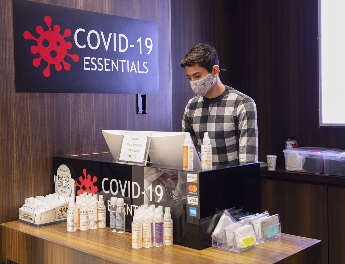 Salesperson Lucas Nascimento works at the computer at the COVID-19 Essentials store in the Foru ...
