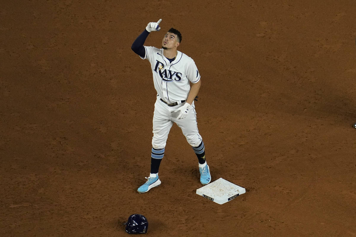 Tampa Bay Rays' Willy Adames celebrates a RBI-double against the Los Angeles Dodgers during the ...