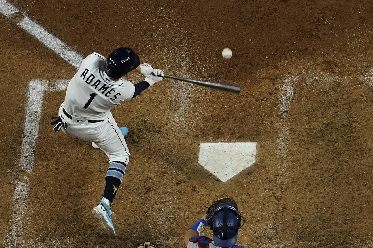 Tampa Bay Rays' Willy Adames hits a RBI-double against the Los Angeles Dodgers during the fifth ...
