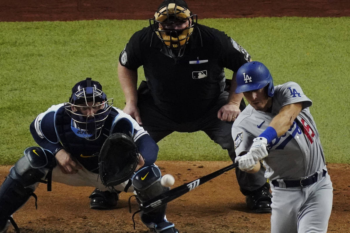 Los Angeles Dodgers' Austin Barnes hits a home run during the sixth inning in Game 3 of the bas ...