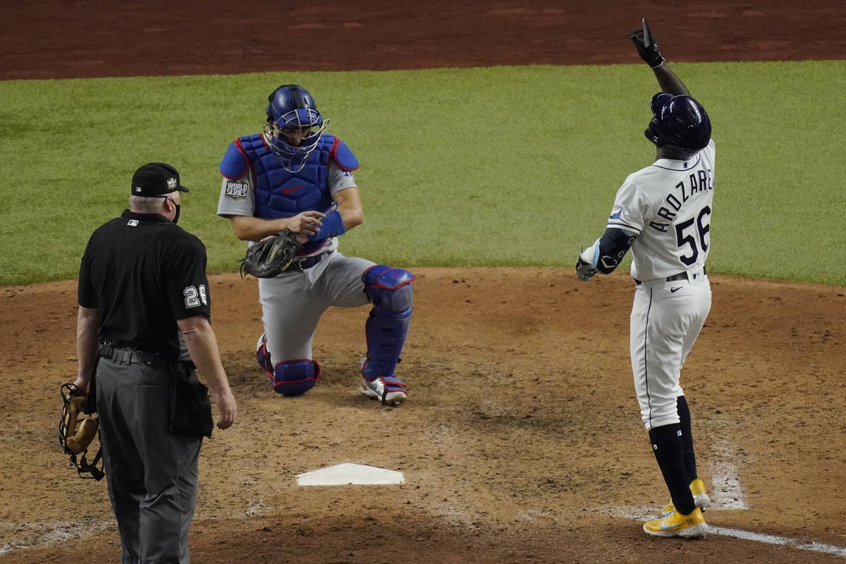 Tampa Bay Rays' Randy Arozarena celebrates home run during the ninth inning in Game 3 of the ba ...