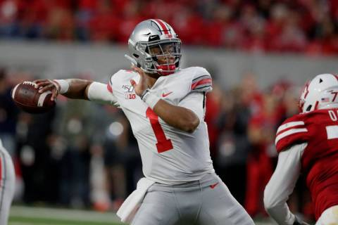FILE - In this Saturday, Sept. 28, 2019, file photo, Ohio State quarterback Justin Fields (1) t ...