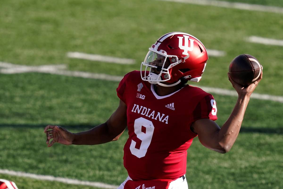 Indiana quarterback Michael Penix Jr. (9) throws during the first half of an NCCAA college foot ...