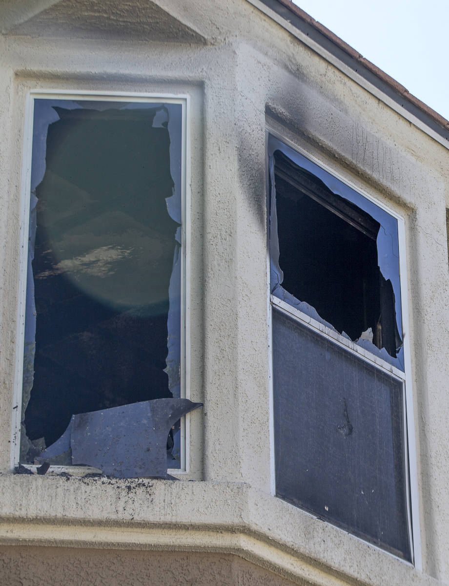 Burned out windows at an apartment in a complex at 10115 Jeffreys Street, near South Eastern Av ...