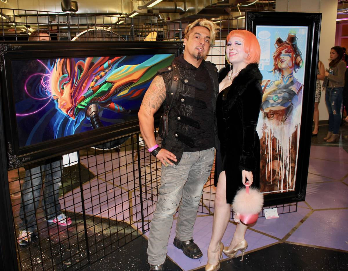 Artists Gear Duran and Heather Hermann pose with artwork. (AFAN)
