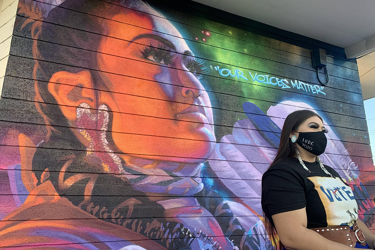 """Amaia Marcos, 19, poses in front of the Las Vegas Indian Center's new """"Our Voices Matter"""" mural ..."""