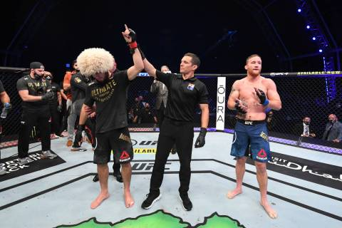 ABU DHABI, UNITED ARAB EMIRATES - OCTOBER 25: (L-R) Khabib Nurmagomedov of Russia celebrates h ...