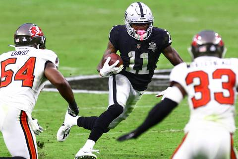 Las Vegas Raiders wide receiver Henry Ruggs III (11) runs the ball past Tampa Bay Buccaneers in ...
