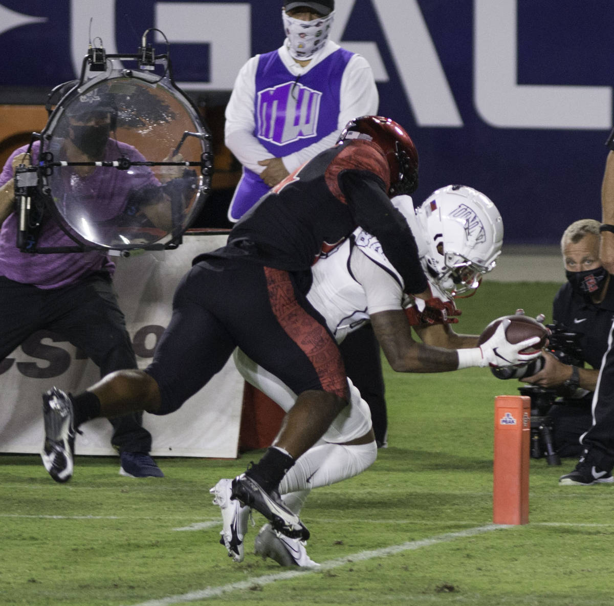 San Diego State's Tariq Thompson tries to prevent the touchdown by UNLV's Steve Jenkins dur ...