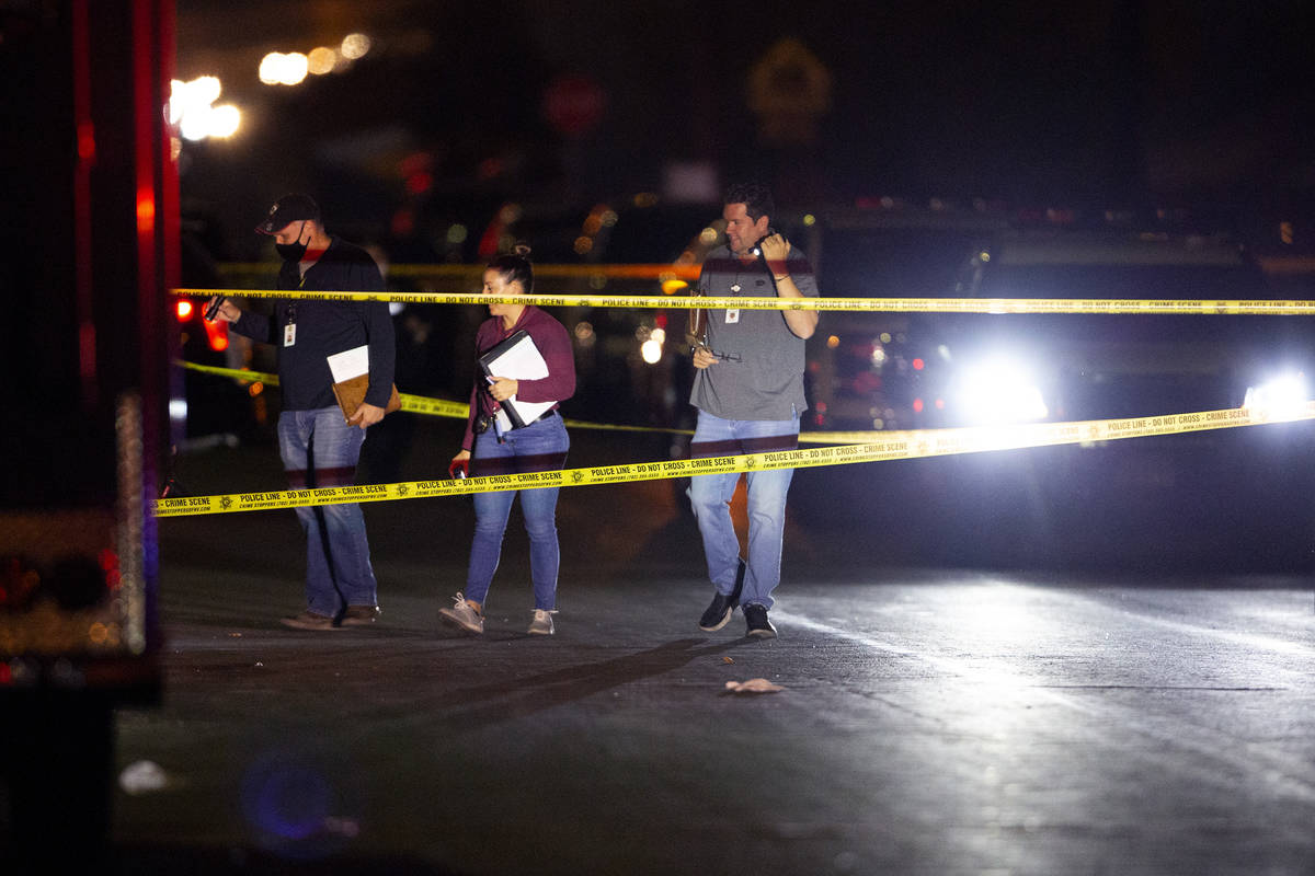 Metropolitan police investigate a homicide in the 2900 block of Marlin Avenue on Saturday, Oct. ...