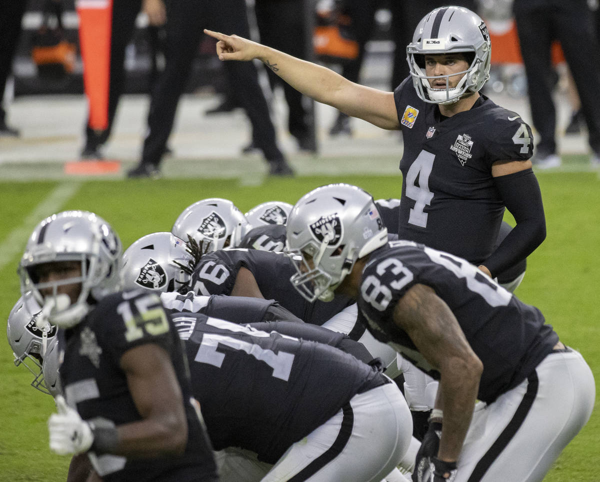 Las Vegas Raiders quarterback Derek Carr (4) calls an audible in the fourth quarter during an N ...