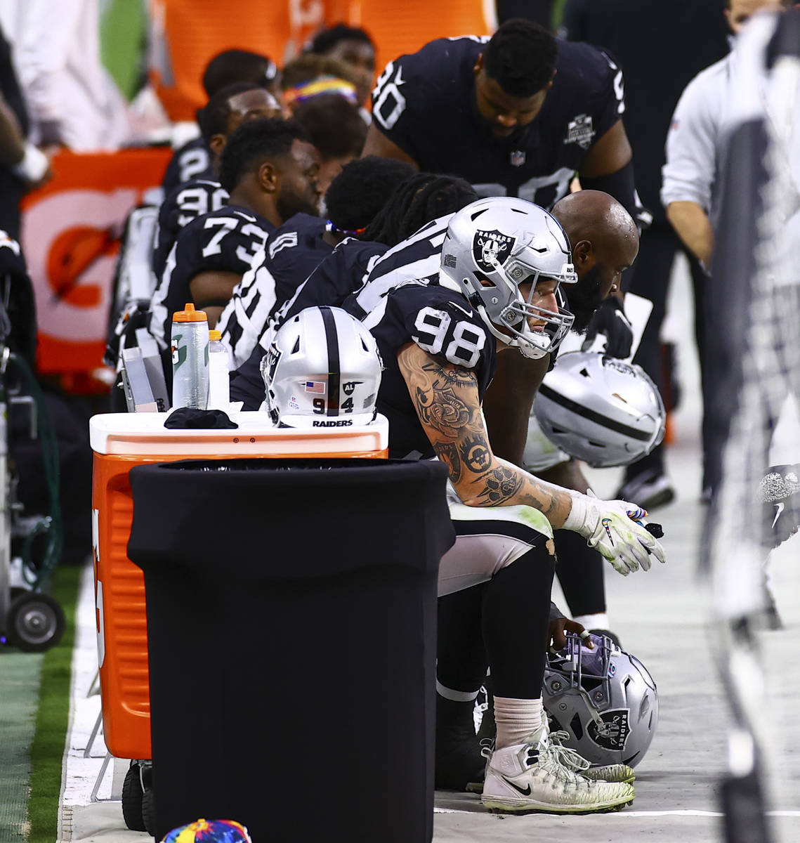 Las Vegas Raiders defensive end Maxx Crosby (98) looks on from the sidelines in the fourth quar ...