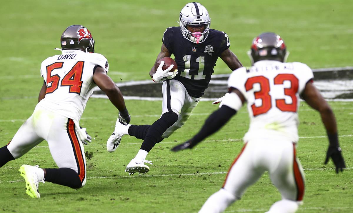 Las Vegas Raiders wide receiver Henry Ruggs III (11) runs the ball past Tampa Bay Buccaneers in ...