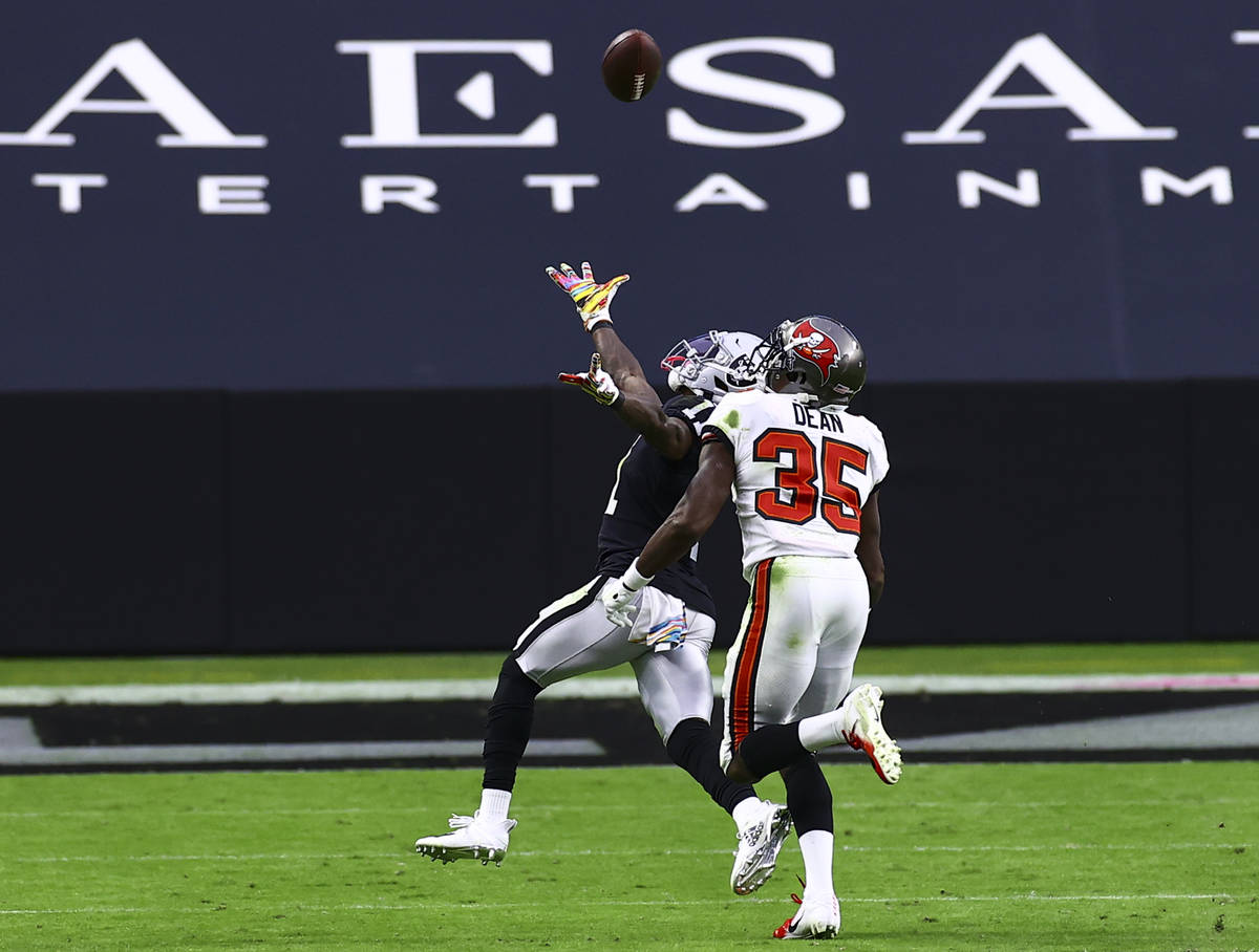 Las Vegas Raiders wide receiver Henry Ruggs III (11) comes up short on a catch under pressure f ...