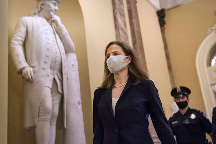 Judge Amy Coney Barrett, President Donald Trump's nominee for the Supreme Court, arrives for cl ...