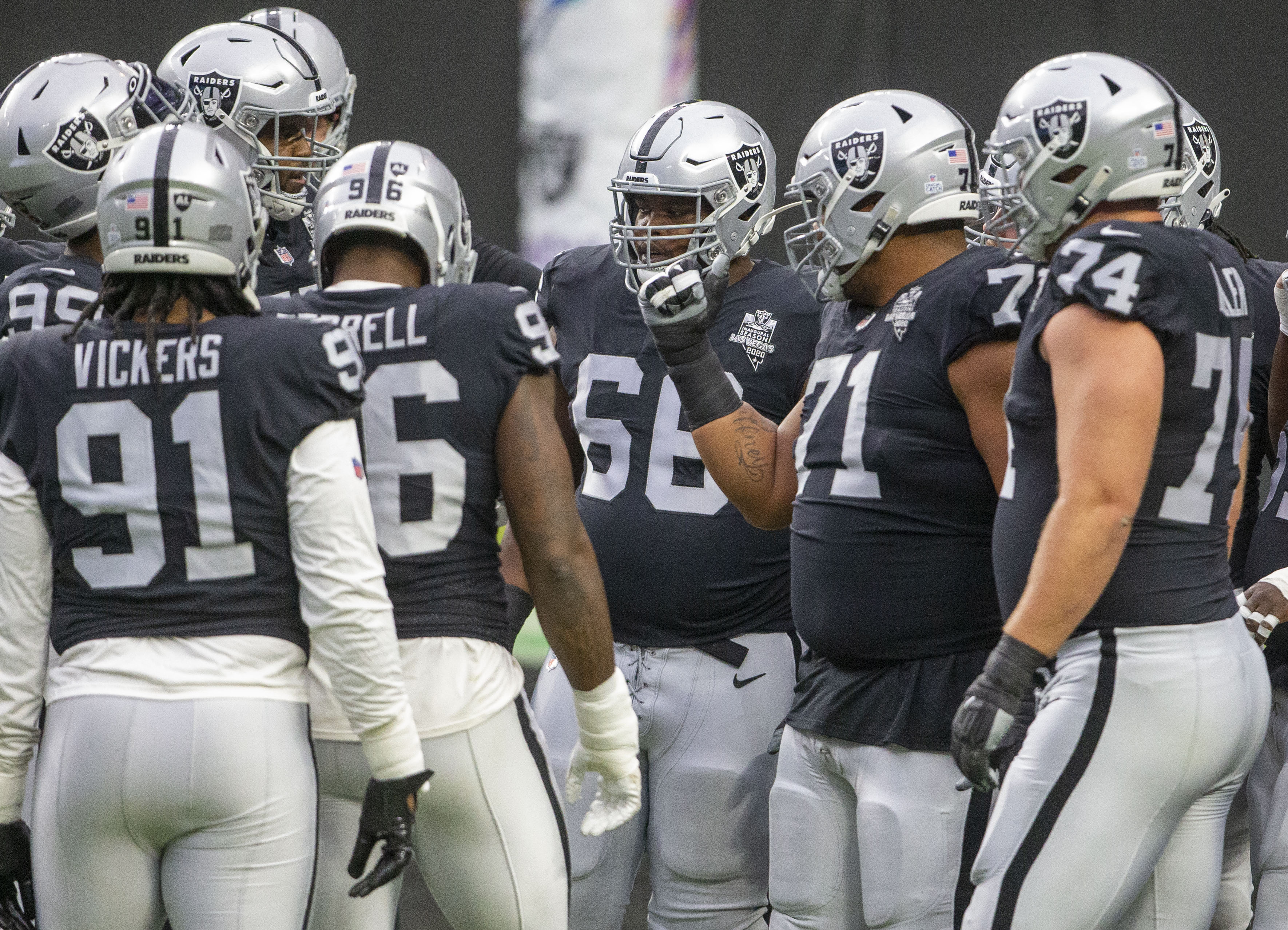 Las Vegas Raiders offensive guard Gabe Jackson (66) is seen gathered with defensive linemen and ...