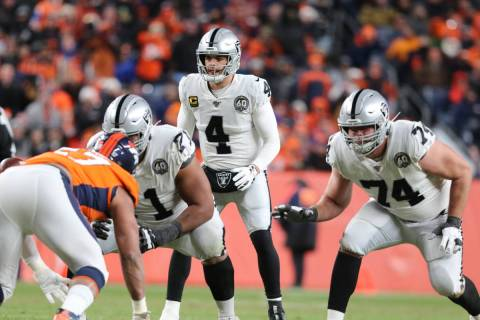 Oakland Raiders quarterback Derek Carr (4) sets up behind his offensive linemen Rodney Hudson ( ...
