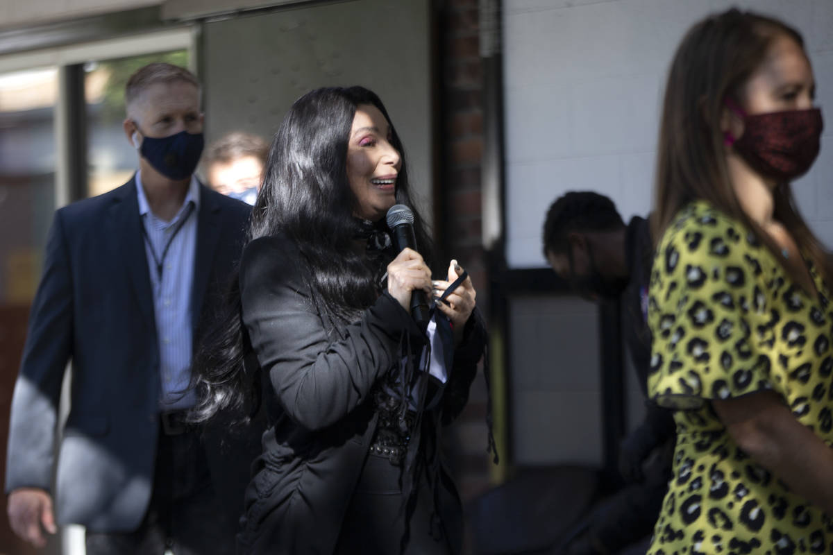 Cher walks on stage to campaign for Joe Biden and Kamala Harris at an event geared toward the L ...