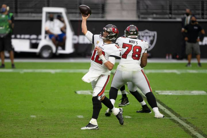 Tampa Bay Buccaneers quarterback Tom Brady (12) throws against the against the Las Vegas Raider ...
