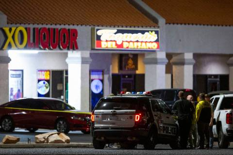 Metropolitan police investigate a homicide at a business near 3603 North Las Vegas Boulevard on ...
