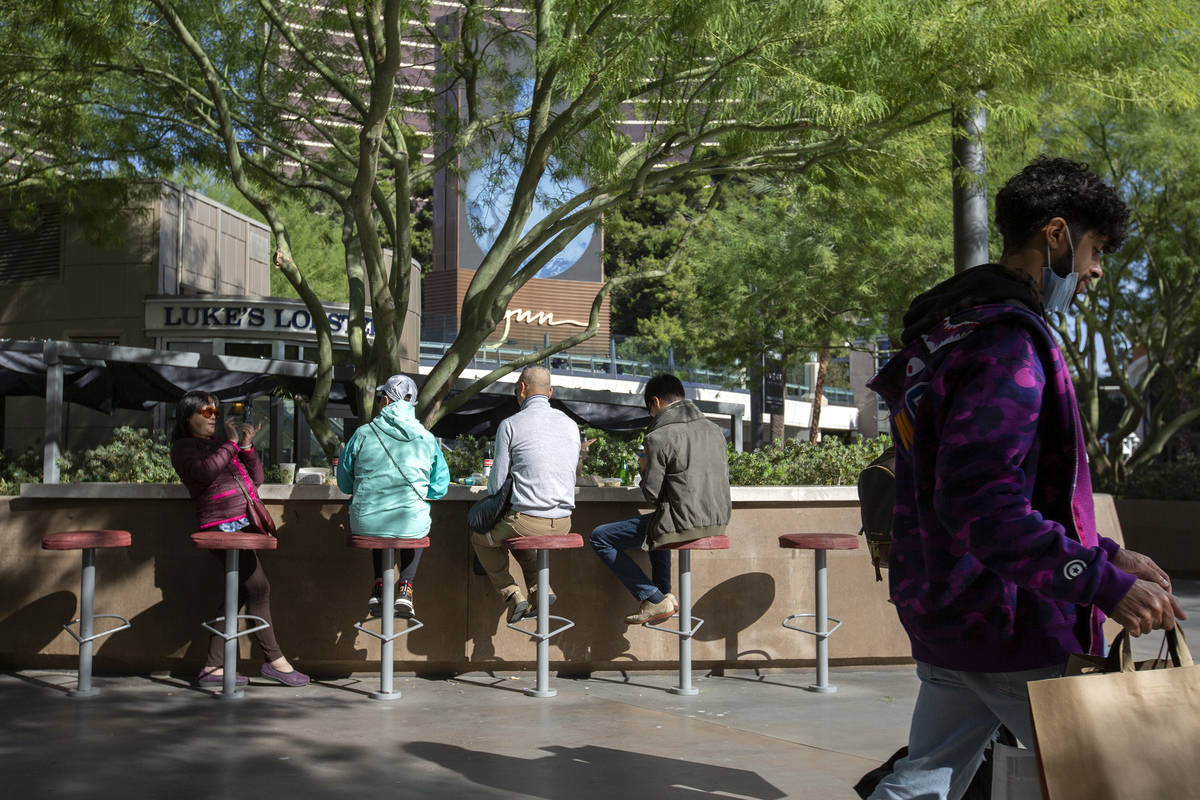 Visitors to the Las Vegas Strip traded their summer attire for jackets on Monday, Oct. 26, 2020 ...