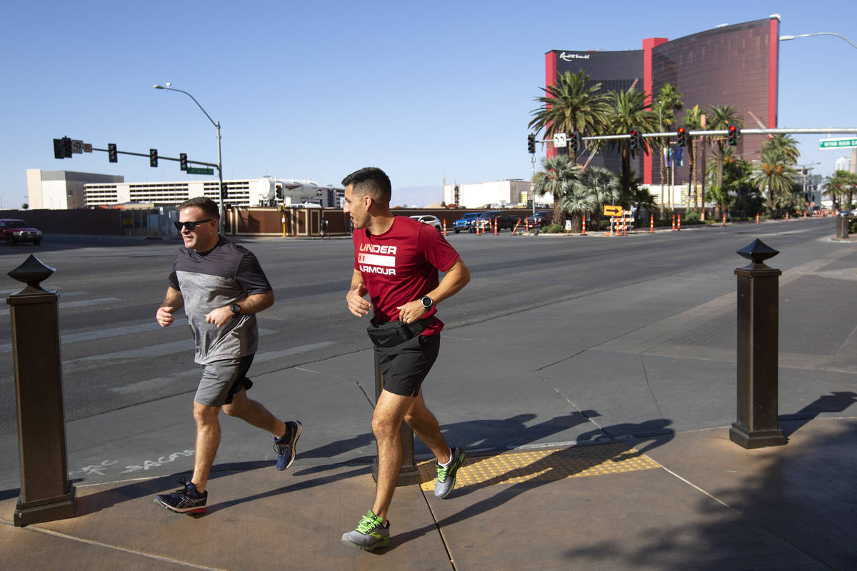 Runners take advantage of cooler weather on the Las Vegas Strip on Monday, Oct. 26, 2020. (Elle ...
