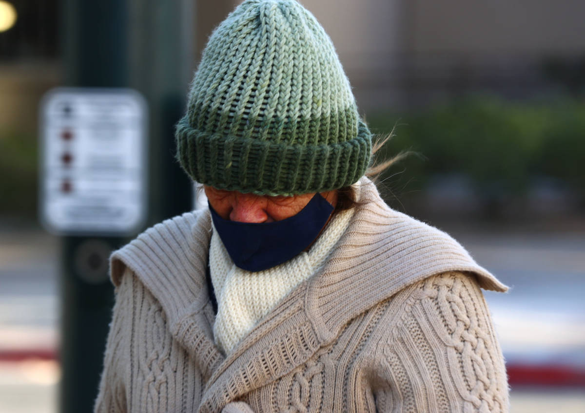 A pedestrian bundled up for cold weather as she walks along East Clark Avenue, on Monday Oct. 2 ...