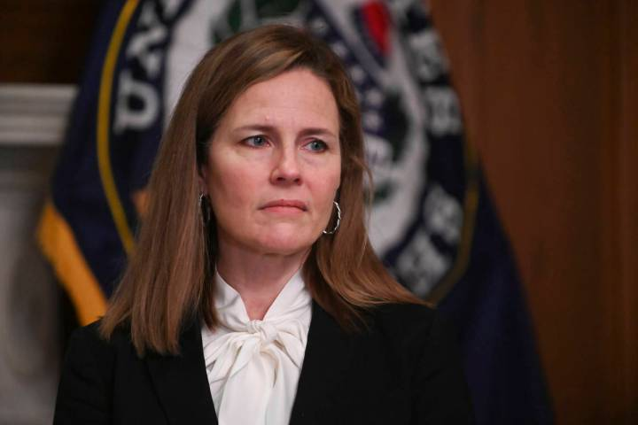 In this Oct. 1, 2020, file photo Supreme Court nominee Judge Amy Coney Barrett, meets with Sen. ...