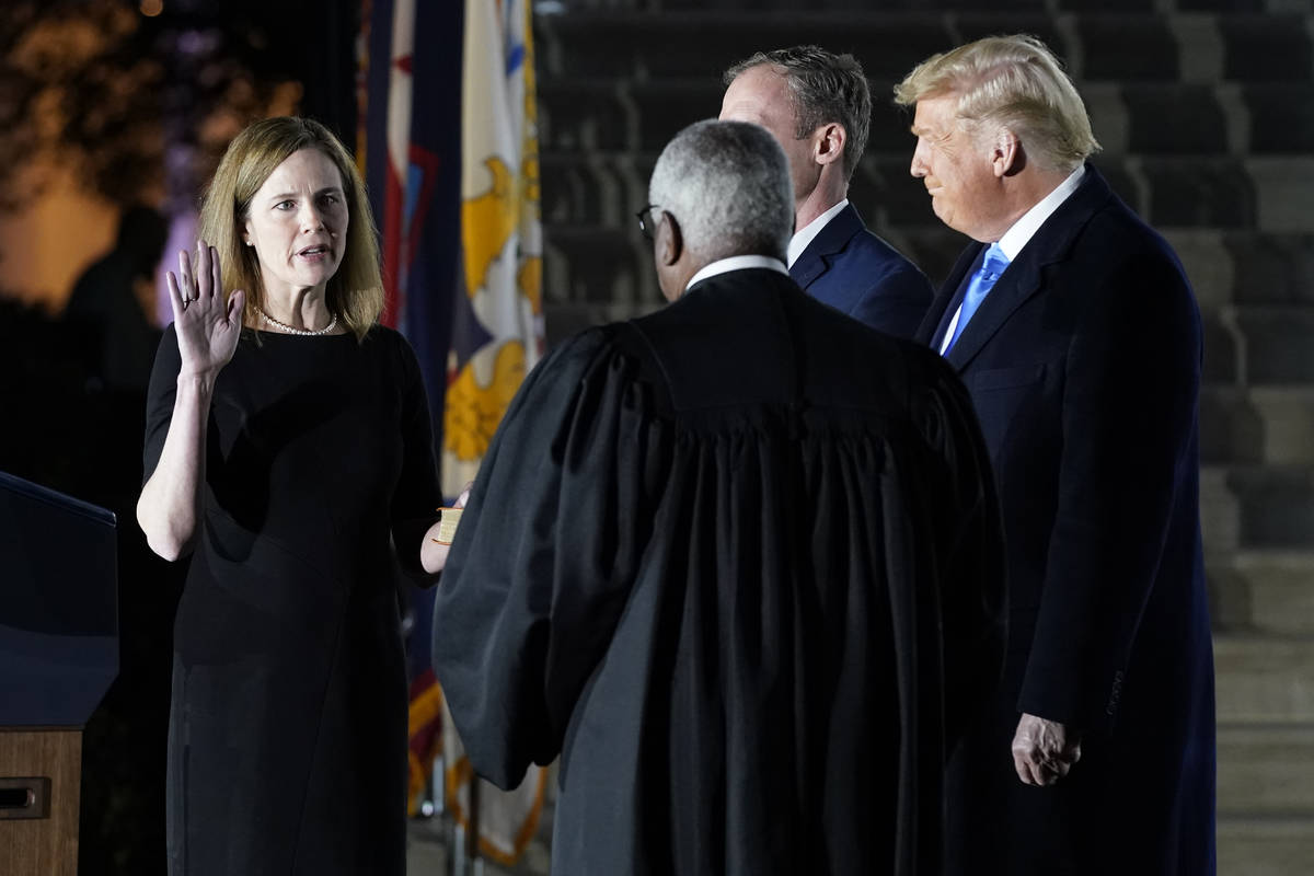 President Donald Trump watches as Supreme Court Justice Clarence Thomas administers the Constit ...