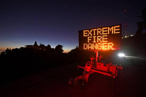 A roadside sign warns motorists of extreme fire danger on Grizzly Peak Boulevard, in Oakland, C ...