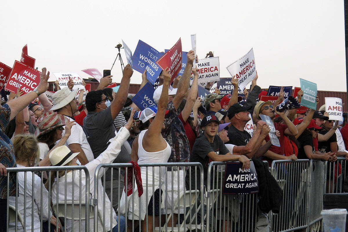 """President Donald Trump's supporters wave placards and chant """"USA USA USA"""" as they wait for the ..."""
